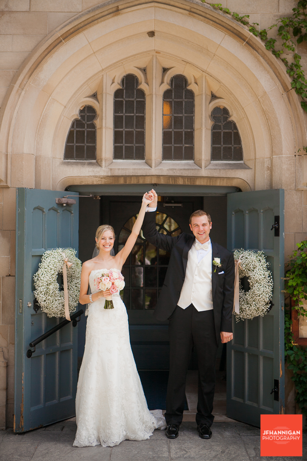 bride and groom at church entrance