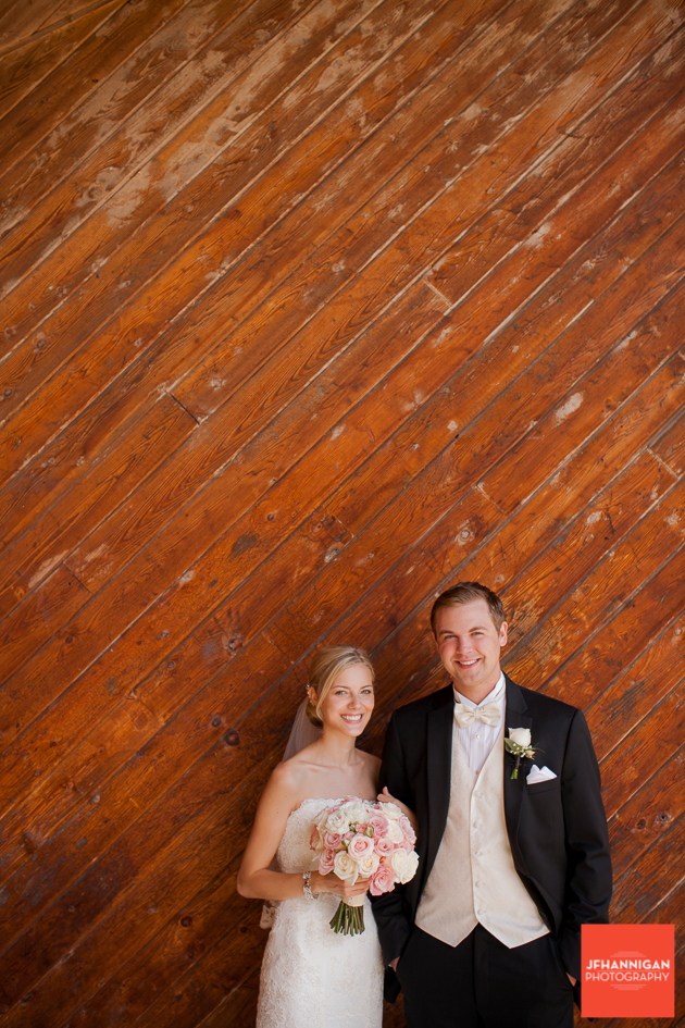 bride and groom wood wall in background