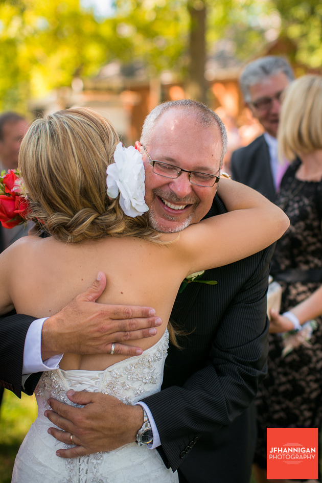 father-in-law greeting bride following wedding ceremony