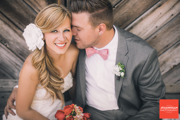 bride and groom close up in front of wood doors