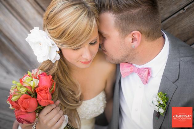 bride as groom nestles close