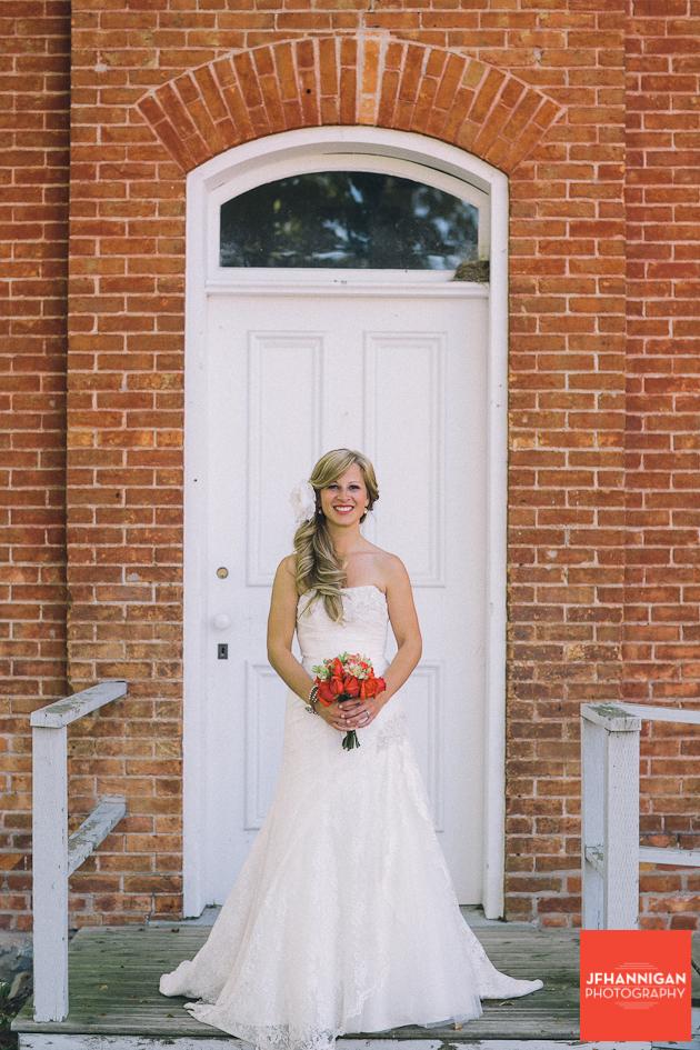 bride posed at door of old brick building Wainfleet