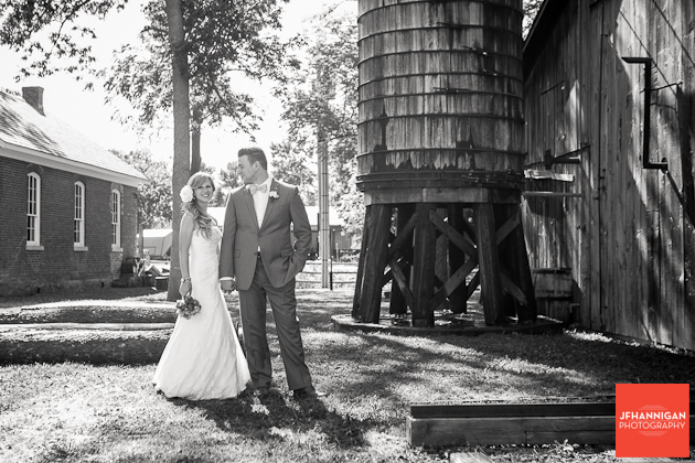 bride and groom beside vintage silo at Wainfleet Heritage Village