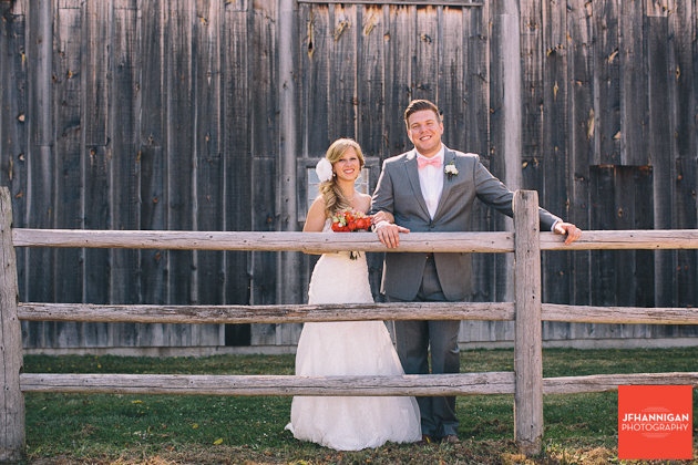 bride and groom in front of barn side Niagara Wedding Photographer