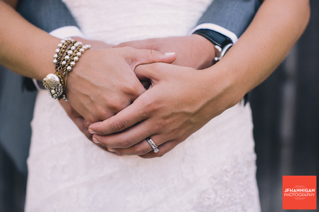 bride and groom hands showing bride's rings and bracelet