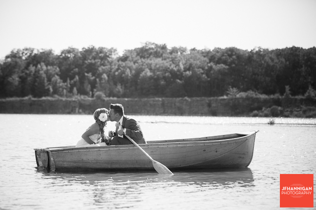 bride and groom in row boat at quarry in Wainfleet