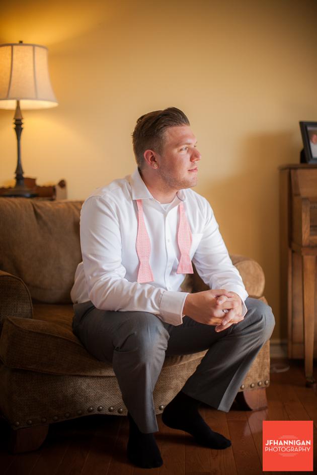 groom sitting in living room