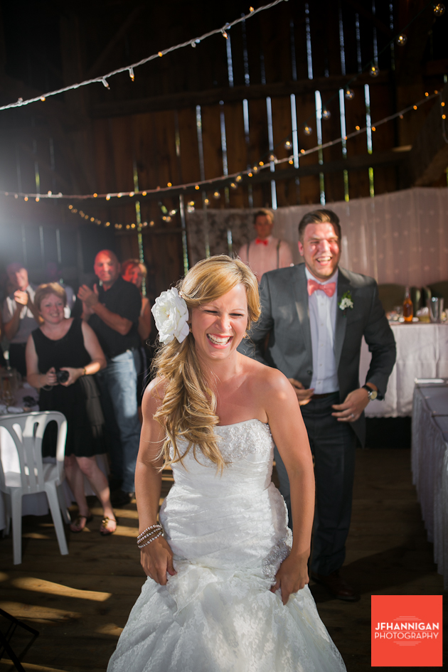 bride and groom at barn reception