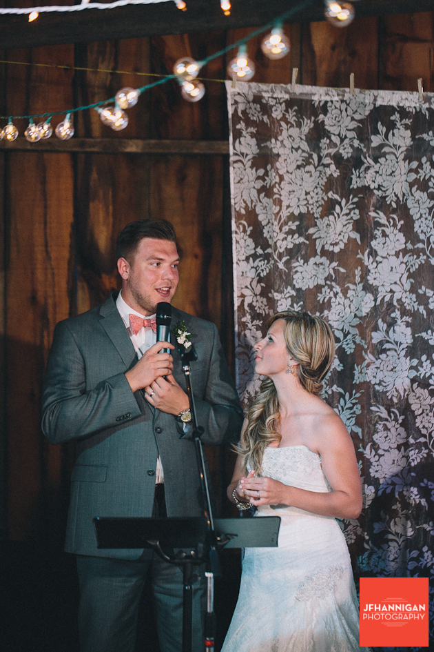 bride intently watches groom give his speech