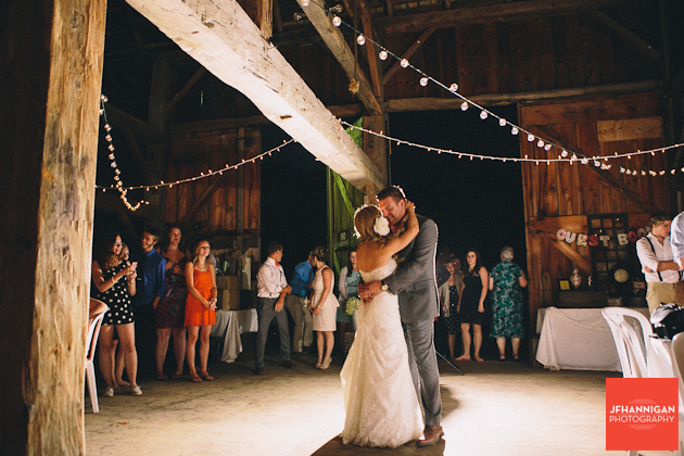 bride and groom first dance barn reception