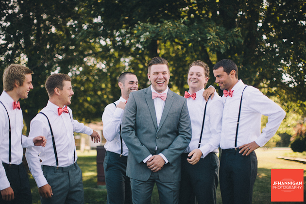 Groom and party  under trees