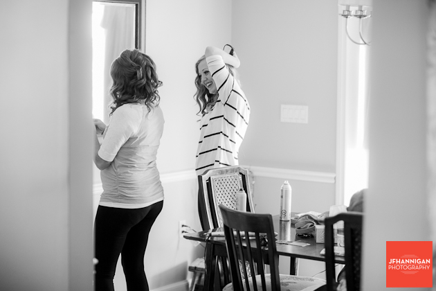 bride and attendant in preparation for wedding day