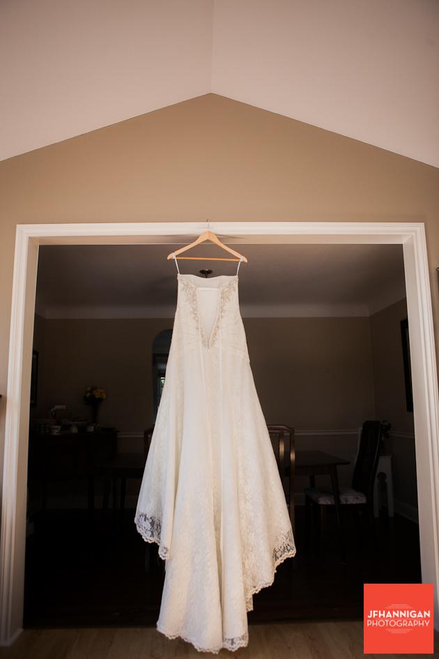 bride's dressing hanging in double doorway