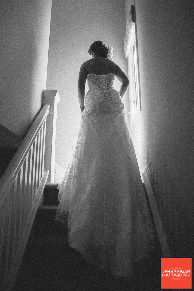 bride on stair case showing dress train