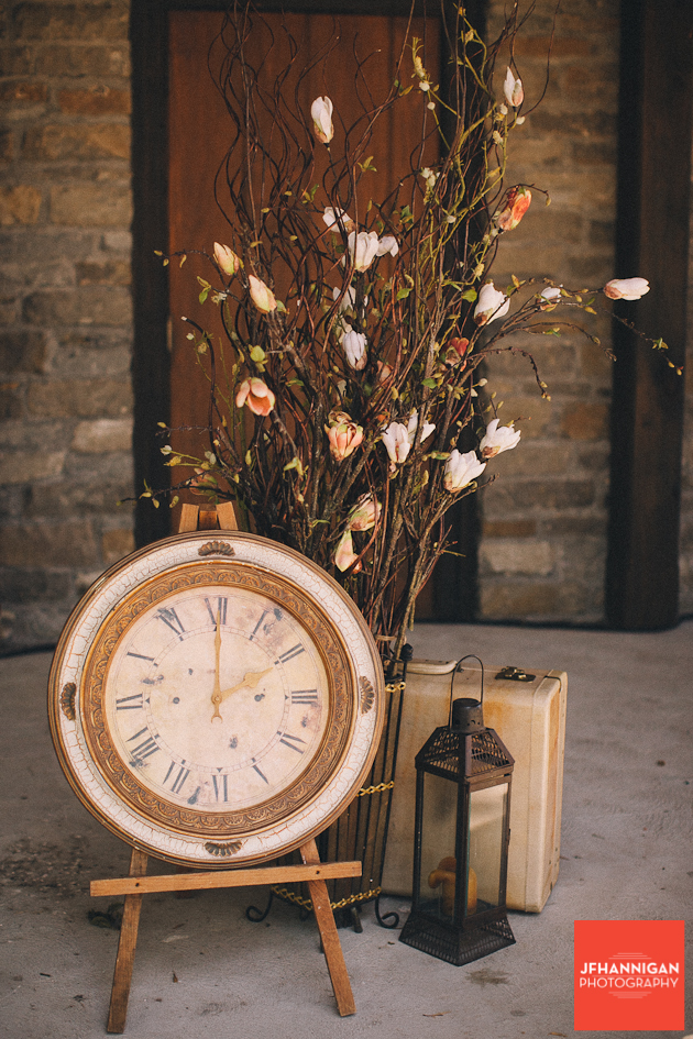 wedding decorations:  clock, lantern, suitecase and flowers