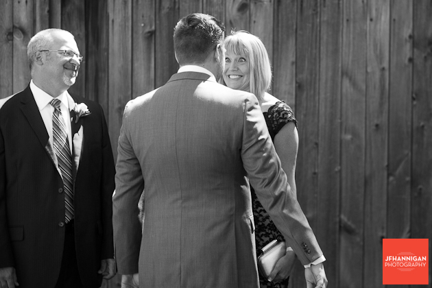 groom with excited parents before wedding