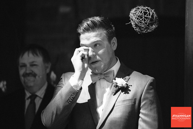 groom showing emotion at the entrance of bridal party