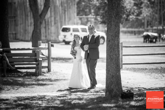 bride and father entering at outdoor wedding at Wainfleet Heritage Village