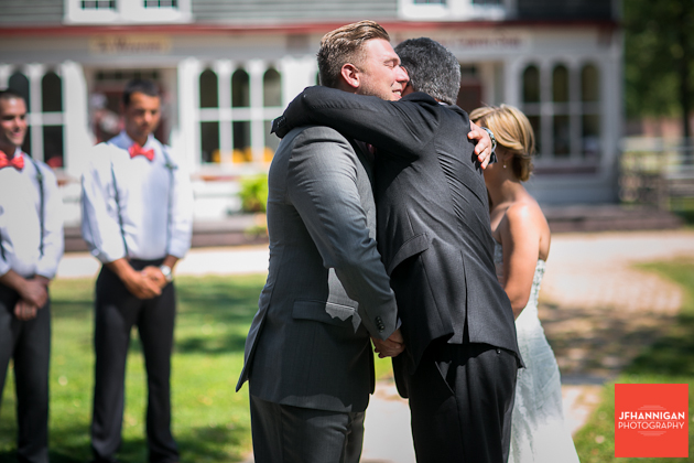 father of bride hugs groom as he gives his daugher away