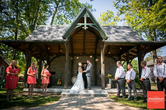 bride and groom exchange vows at gazebo in Wainfleet Heritage Village