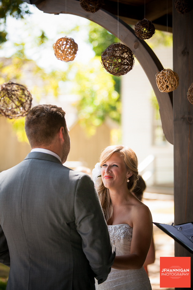 bride looks into groom's eyes as he says his vows