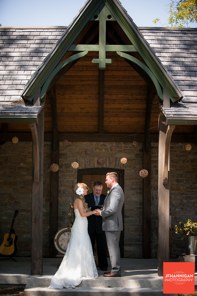 groom says his vows at outdoor wedding
