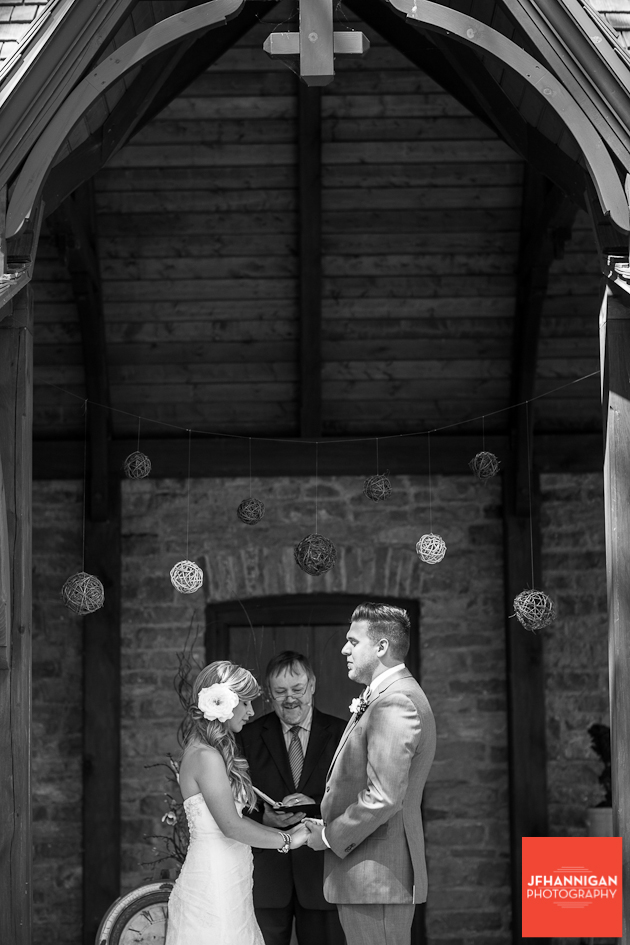 bride and groom during prayer at outdoor wedding at Wainfleet Heritage Village