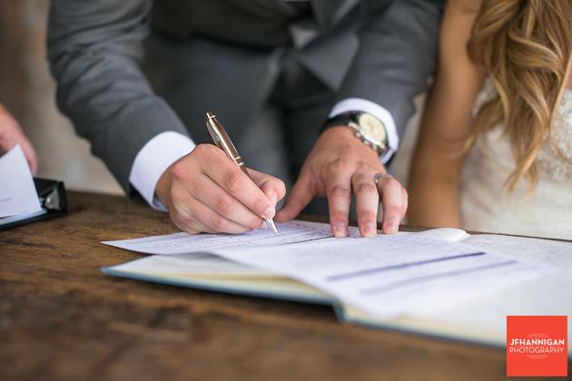 groom signing marriage license Niagara Wedding Photographer