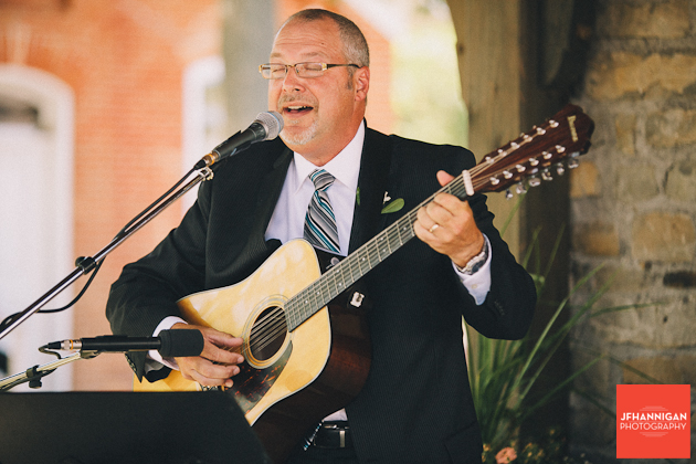 groom's father singing during signing of register