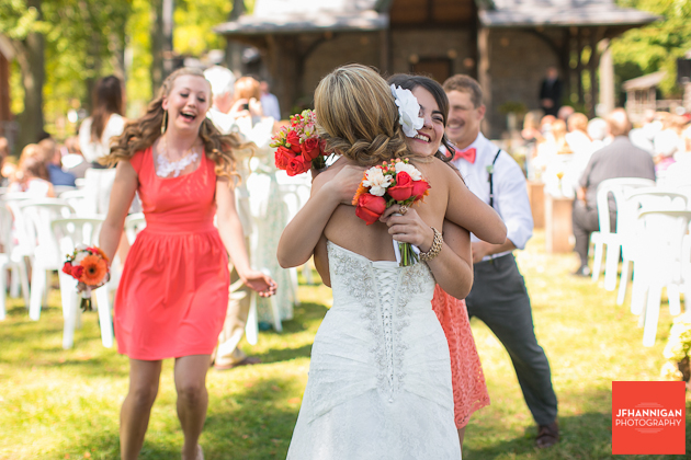 bride and bridesmaids following the ceremony of outdoor wedding